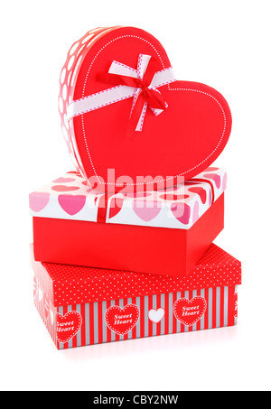 Red romantic gift boxes isolated on white background, conceptual image of love & celebration - Stock Photo