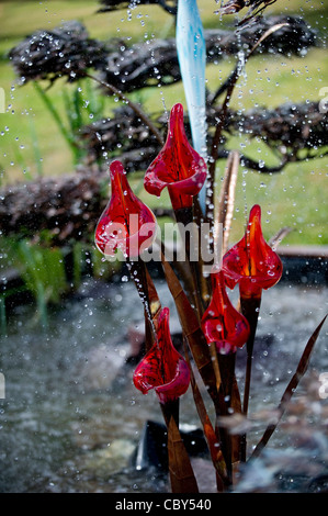 Glass & Metal Red Lily Fountain on Display at the Royal Hampton Court Flower Show - Stock Photo