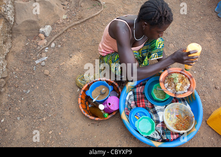 Ms. Hawa Samura runs a mobile food stall in Freetown, Sierra Leone, West Africa. - Stock Photo