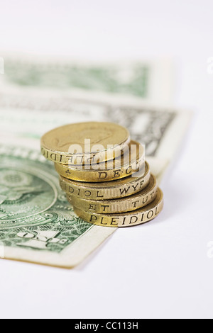 The American dollar and UK pound coins on a white background. - Stock Photo