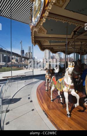 USA, New York State, New York City, Merry go-round near Brooklyn Bridge - Stock Photo