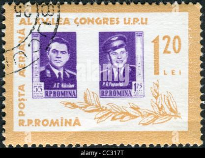 A stamp printed in the Romania, portrayed Soviet cosmonauts Andriyan Nikolayev and Pavel Popovich, circa 1963 - Stock Photo