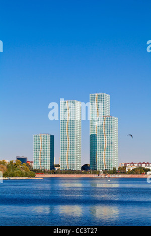 Kazakhstan, Astana, View of appartment buildings reflecting in Ishim River - Stock Photo
