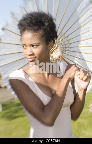 Woman in White with Paper Umbrella - Stock Photo