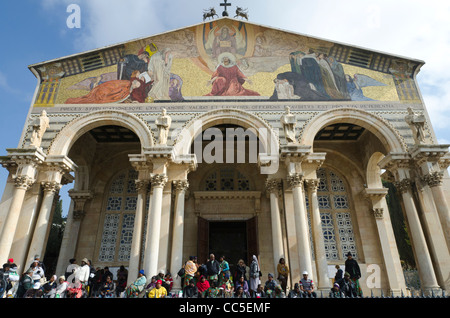 Pilgrims in front of the Chrurh of all Nations. Gethsemane. Jerusalem. Israel - Stock Photo