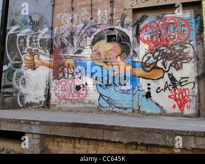 Abandoned workshop painted with graffiti, 798 Art Zone, Beijing, China - Stock Photo
