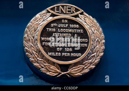 Plaque on world record holding steam locomotive 'Mallard,' on display at National Railway Museum, York, England - Stock Photo