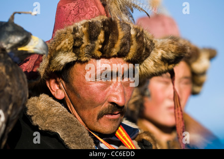 Kazakh eagle hunters in the Altai mountains region of western Mongolia. - Stock Photo
