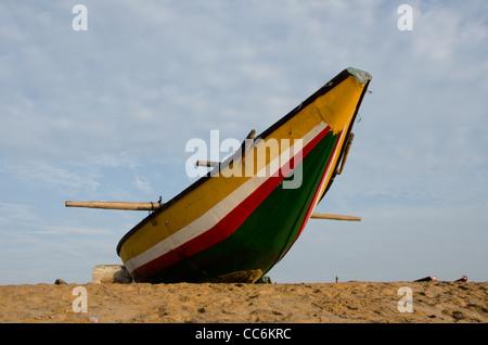 COLORFUL FISHING BOAT STANDING ON THE BEACH,PURI , ORISSA, INDIA - Stock Photo