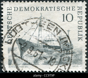 DDR - CIRCA 1961: A stamp printed in DDR, shows Trawler, circa 1961 - Stock Photo