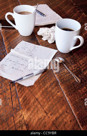 Molecular calculations on a paper napkin on a coffee shop table - Stock Photo