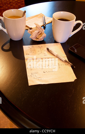Molecular calculations on paper napkin on coffee shop table - Stock Photo