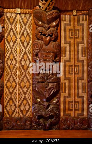 Waitangi Treaty Grounds, New Zealand. Maori Wood Carving inside Meeting House. - Stock Photo