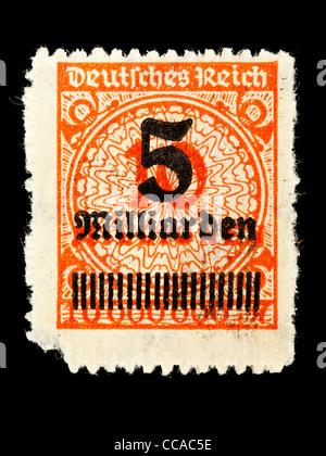 Postage stamp: German Empire, 1923, 5 billion mark on top of 10 million, mint condition - Stock Photo