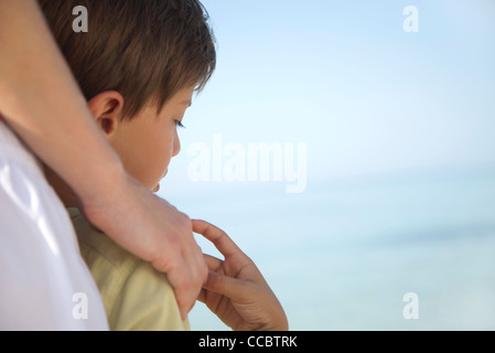 Boy holding mother's hand, cropped - Stock Photo