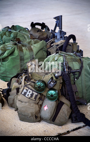 An FBI SWAT (Special Weapons and Tactics) team's equipment is ready for a practice session at a 'Live Fire Kill - Stock Photo