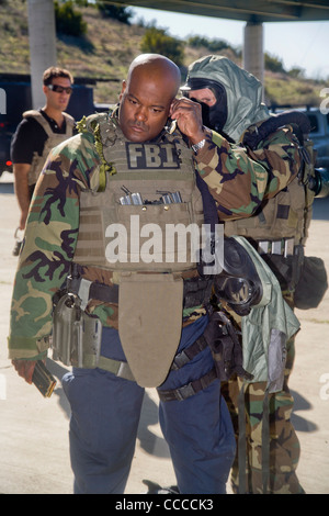 FBI SWAT (Special Weapons and Tactics) team members don specialized 'Weapons of Mass Destruction' equipment for - Stock Photo