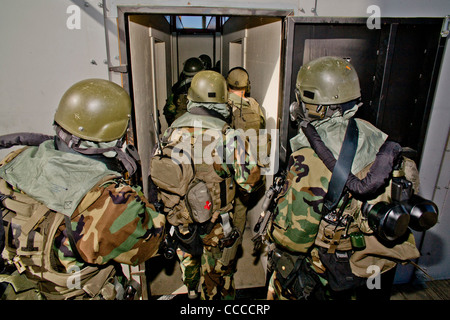 FBI SWAT (Special Weapons and Tactics) team members wear specialized 'Weapons of Mass Destruction' equipment during - Stock Photo