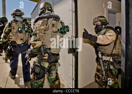 FBI SWAT (Special Weapons and Tactics) team member wears specialized 'weapons of Mass Destruction' equipment  during - Stock Photo