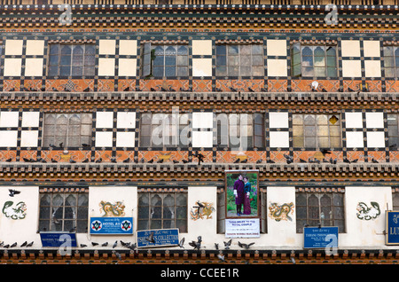 Poster of the royal couple at a multi-storey commercial building in the centre of Thimphu, Bhutan - Stock Photo