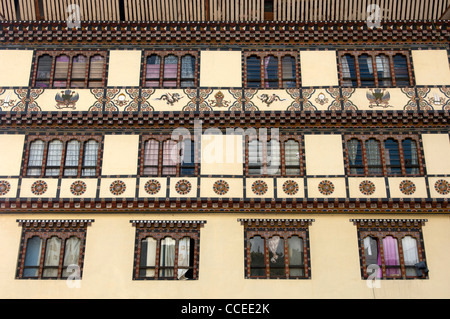 Traditional front with ornate windows of a commercial building in the centre of Thimphu, Bhutan - Stock Photo