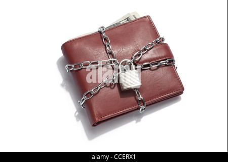 A brown leather wallet containing dollar notes with chain and padlock locked - Stock Photo