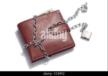 A brown leather wallet containing dollar notes with chain and padlock unlocked - Stock Photo