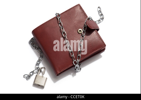 A brown leather wallet with chain and padlock unlocked - Stock Photo