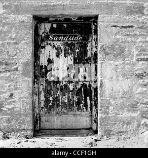A door into an old stone building named Sandside in a small village outside Thurso on Scotland's North Coast - Stock Photo