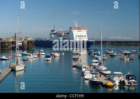 UK Channel Islands Guernsey Condor commercial shipping ferry entering St Peter Port harbour yachts in foreground - Stock Photo