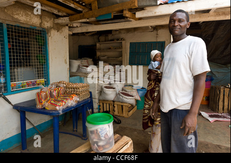 A man with sells eggs bread rice and pulses in Moshi Kilimanjaro Region Tanzania - Stock Photo