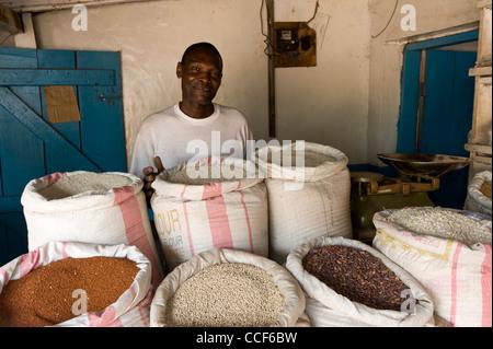 A man sells rice and pulses in Moshi Kilimanjaro Region Tanzania - Stock Photo