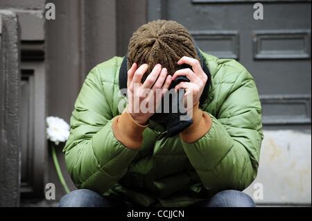 Dec. 10, 2010 - Manhattan, New York, U.S. - Distraught friend Markus Jarrow, of Fort Greene, Brooklyn, drops off - Stock Photo