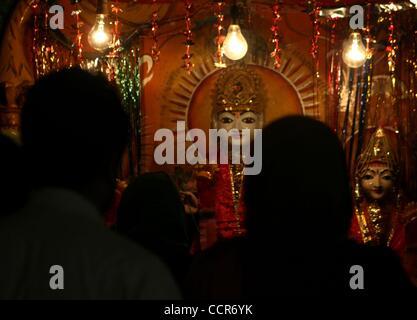 Mar 24, 2010 - Srinagar, Kashmir, India - Kashmiri Pandits worship inside a Ram temple during Ramnavmi in Srinagar, - Stock Photo