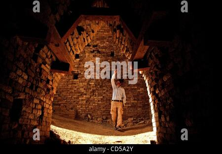Mar 01, 2008 - Tallil, Iraq - Curator DIEF MOHSSEIN NAIIF AL-GIZZY shows one of the royal tombs at the Sumerian - Stock Photo