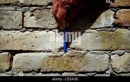 Mar 01, 2008 - Tallil, Iraq - Curator DIEF MOHSSEIN NAIIF AL-GIZZY points to Cuneiform writing on a wall at Sumerian - Stock Photo