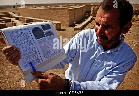 Mar 01, 2008 - Tallil, Iraq - Curator DIEF MOHSSEIN NAIIF AL-GIZZY points to a bible passage about Abraham in front - Stock Photo