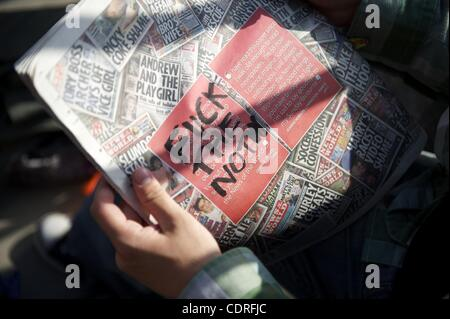 July 10, 2011 - London, England, UK - Protestors write obscenities on the final issue of the News of the World, - Stock Photo