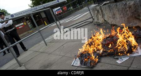 July 10, 2011 - London, England, UK - Protestors burn copies of The News of the World outside the News International - Stock Photo