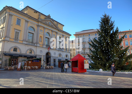 Piazza Riforma and the Town Hall in Lugano, Ticino, Switzerland during the Christmas season with Christmas Tree - Stock Photo