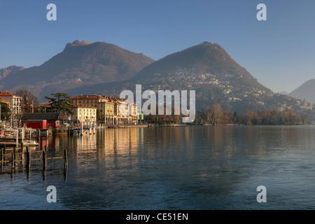 View of the city of Lugano, Ticino, Switzerland and the lakeside promenade of Lake Lugano. - Stock Photo
