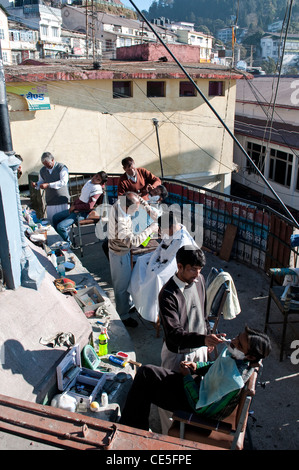 Barber shop in the open air, Mussoorie, Uttarakhand, India - Stock Photo