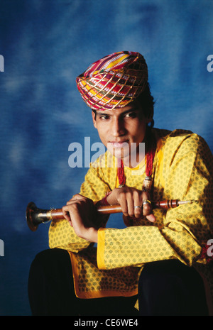 BDR 83387 : portrait of indian rajasthani folk musician posing with wind musical instrument shehnai rajasthan india - Stock Photo