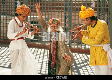 BDR 83393 : indian rajasthani folk dancer musicians playing musical instrument flute jaipur rajasthan india MR#657 - Stock Photo