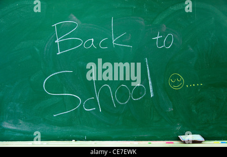 Back to school text on the blackboard - Stock Photo