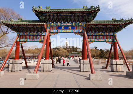 Entrance gate at Beihai Park, Beijing, China, with the White Pagoda behind. - Stock Photo