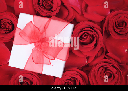 Valentines gift on rose background - Stock Photo