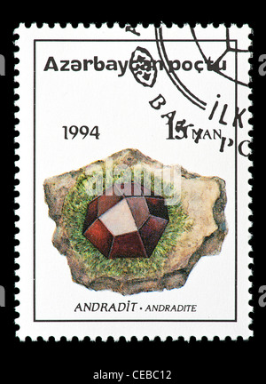 Postage stamp from Azerbaijan depicting andradite crystals - Stock Photo