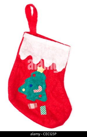 Christmas red sock isolated on white background. Green tree on it. - Stock Photo