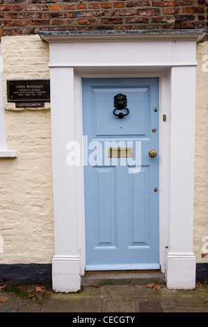 Pale blue door of house where John Woolman (anti-slavery campaigner) died (information on plaque by doorway) - York, - Stock Photo